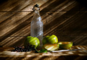 Arrange Posters - Old bottle with green apples Poster by Sandra Cunningham