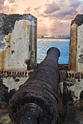Artillery Photo Framed Prints - Old Cannon Overlooking San Juan Bay Framed Print by George Oze