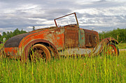 Rusted Cars Photos - Old Car in the Storm Clouds by Randy Harris