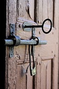 Wooden Hand Photos - Old door of wood with its worn lock by Bernard Jaubert
