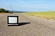 Out Of Context Prints - Old fashioned TV on empty countryside road Print by Sami Sarkis
