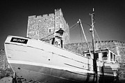 Fit Prints - Old Fishing Boat In Front Of Carrickfergus Castle In Northern Ireland Print by Joe Fox