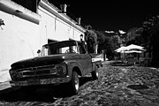 Barrio Framed Prints - old ford pickup truck on historic paved spanish street Barrio Historico Colonia Del Sacramento Framed Print by Joe Fox
