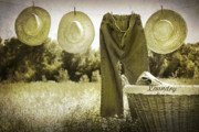 Basket Prints - Old grunge photo of jeans and straw hats  Print by Sandra Cunningham