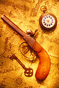 Old Watch Framed Prints - Old gun on old map Framed Print by Garry Gay