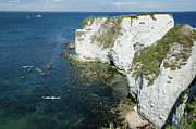 Photograph Photo Framed Prints - OLD HARRY ROCKS sea kayak tour visiting the white Jurassic cliffs on the Dorset coast england uk Framed Print by Andy Smy