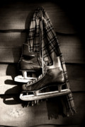 Sepia Art - Old hockey skates with scarf hanging on a wall by Sandra Cunningham