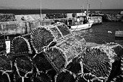 Lobster Pots Prints - old lobster pots piled up at John OGroats harbour scotland Print by Joe Fox