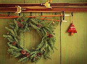 Wreath Art - Old pair of skis hanging with wreath  by Sandra Cunningham