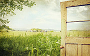 Grungy Prints - Old peeling door with rural  landscape  Print by Sandra Cunningham