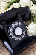 Telephones Prints - Old phone and white roses Print by Garry Gay