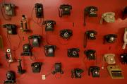 Phones Photos - Old Phones On Display At Museum by Michael Melford