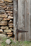 Aging Process Prints - Old Stone Wall With Rustic Wood Door Print by John Stephens
