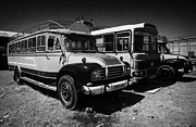 Coaches Prints - old traditional bedford bus coaches parked in Limassol lemesos republic of cyprus europe Print by Joe Fox