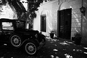 Barrio Framed Prints - old vintage car outside the portuguese museum in Barrio Historico Colonia Del Sacramento Framed Print by Joe Fox