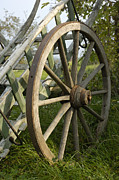 Wagon Wheels Photos - Old wooden cartwheel - Nostalgia by Matthias Hauser