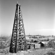 Oklahoma Prints - Old Wooden Derrick Print by Larry Keahey