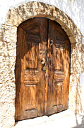 Lindos Posters - Old wooden door in a stone frame in Lindos Poster by David Fernandez