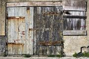Farm Structure Framed Prints - Old Wooden Door Of Building Framed Print by John Short