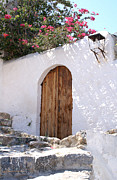 Lindos Posters - Old wooden door on a white wall in Lindos Poster by David Fernandez