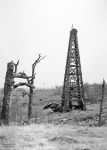 Oil Field Prints - Old Wooden Oil Derrick Print by Larry Keahey