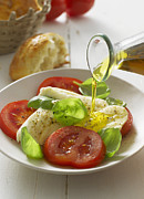 Salad Oil Prints - Olive Oil Pouring On Caprese Salad In Plate, Close Up Print by Westend61