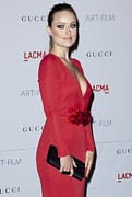 Red Dress Framed Prints - Olivia Wilde Wearing A Gucci Dress Framed Print by Everett