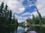Yukon Territory Photos - One Of The Team Fishing On The River by Barry Tessman