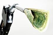 Energy Currency Framed Prints - One US banknote coming out petrol pump nozzle Framed Print by Sami Sarkis