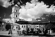 Lazarus Framed Prints - onstreet cafes at St Lazarus Church with belfry larnaca republic of cyprus europe Framed Print by Joe Fox