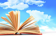 Library Prints - Open book against a blue sky Print by Sandra Cunningham