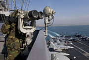 Carrier Prints - Operations Specialist Seaman Stands Print by Stocktrek Images
