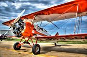 Orange Bi-plane Print by Dan Crosby
