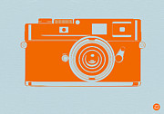 Polaroid Camera Framed Prints - Orange camera Framed Print by Irina  March