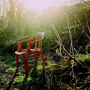 Abandoned Prints - Orange chair Print by Bernard Jaubert