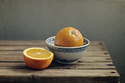 Orange Photo Prints - Orange In Chinese Bowl And Half Orange On Table Print by Copyright Anna Nemoy(Xaomena)