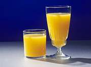 Volume Posters - Orange Juice In Two Containers Poster by Andrew Lambert Photography
