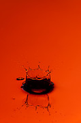 Water Drop Posters - Orange Splash Poster by Steve Gadomski