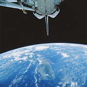 Space Art - Orbiting Shuttle by NASA / Science Source