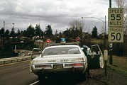 Police Cars Photo Framed Prints - Oregon State Police Stops A Driver Who Framed Print by Everett