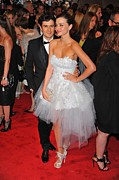 Strapless Dress Photo Framed Prints - Orlando Bloom, Miranda Kerr Wearing Framed Print by Everett