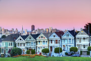 Building Exterior Posters - Painted Ladies At Dusk Poster by Photo by Jim Boud