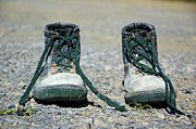 Asphalt Framed Prints - Pair of used work boots on road Framed Print by Sami Sarkis