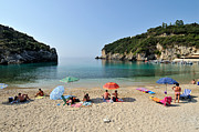 Suntanning Prints - Paleokastritsa beach Print by George Atsametakis