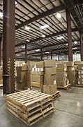 Packaged Framed Prints - Pallets and Boxes in a Warehouse Framed Print by Jetta Productions, Inc