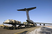 Conveyor Belt Posters - Pallets Await Loading Onto A C-5 Galaxy Poster by Stocktrek Images
