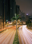 Long Street Prints - Palm Tree Lined Road Leading Through City At Night Print by Gary Yeowell