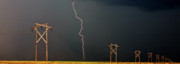 Lightning Prints - Panoramic Lightning Storm and Power Poles Print by Mark Duffy