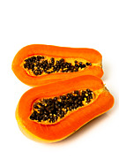 Sliced Originals - Papaya fruit sliced on half by Phalakon Jaisangat