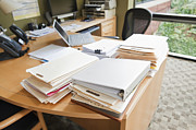 Office Chair Prints - Paperwork on an Office Desk Print by Jetta Productions, Inc